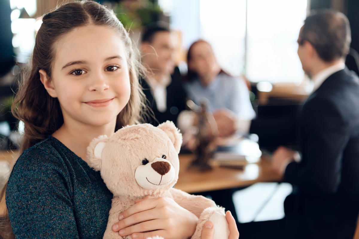 young girl with teddie bear
