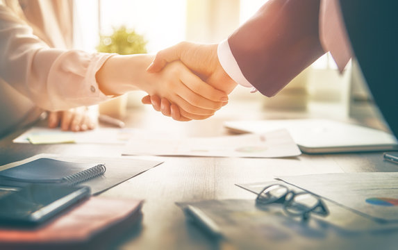 Handshake of attorney and client